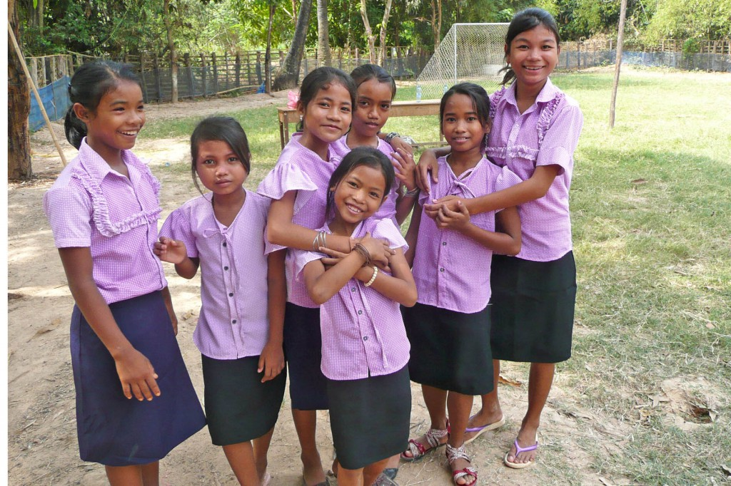 Girls wearing clothes made by the sewing school graduates.