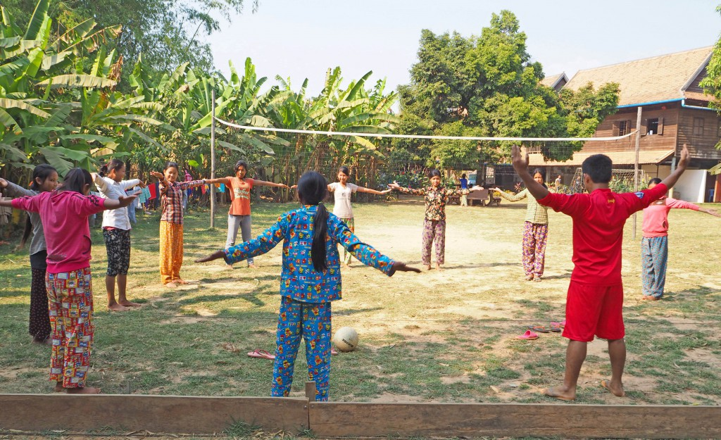 Morning exercises with coach (in red)