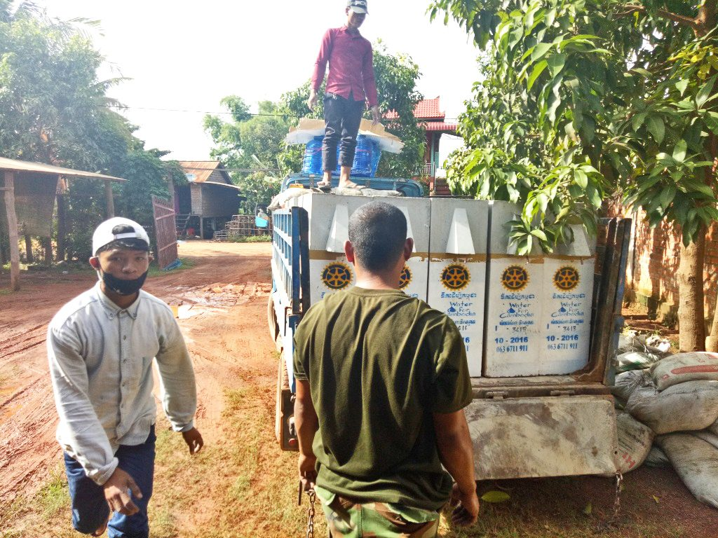 Loading water filters to distribute to families